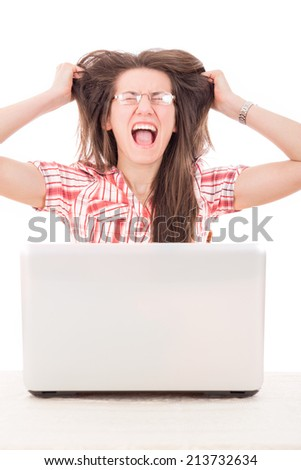 shocked casual woman with glasses looking at laptop and plucking hair from her head because terrible mistake
