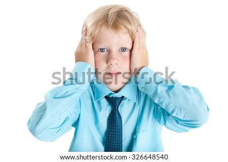Shocked Caucasian blond schoolboy in blue shirt holding his head with hands, isolated on white background - stock photo