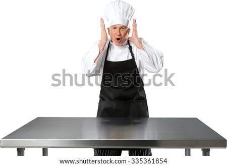 Shocked Caucasian Chef with hands on the sides of his head - Isolated - stock photo
