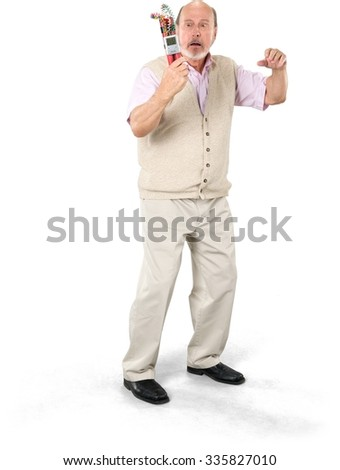 Shocked Caucasian elderly man with short grey hair in casual outfit holding bomb - Isolated - stock photo