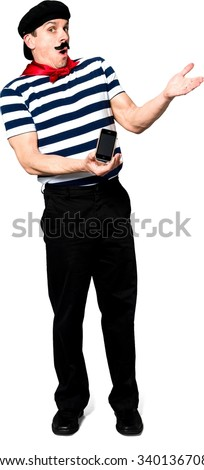 Shocked Caucasian man with short black hair in costume holding mobile phone - Isolated - stock photo