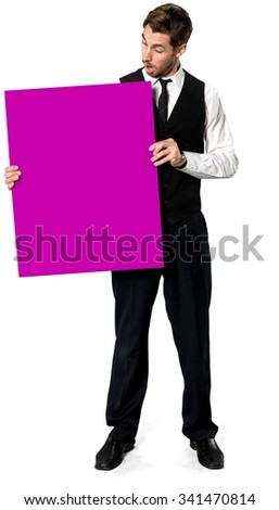 Shocked Caucasian man with short dark brown hair in business formal outfit holding large sign - Isolated