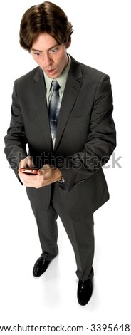 Shocked Caucasian man with short dark brown hair in business formal outfit texting on phone - Isolated