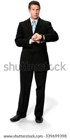 Shocked Caucasian man with short medium blond hair in business formal outfit holding wristwatch - Isolated