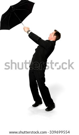 Shocked Caucasian man with short medium blond hair in business formal outfit using umbrella - Isolated - stock photo