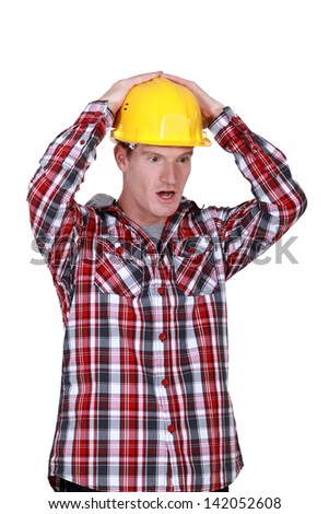 Shocked construction worker - stock photo
