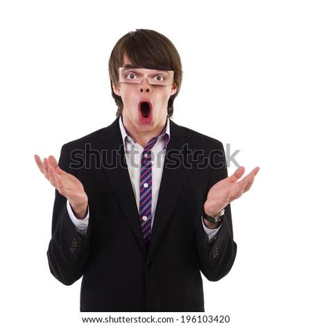 Shocked funny guy. Shocked young man with fake eyes gesturing. Waist up studio shot isolated on white. - stock photo