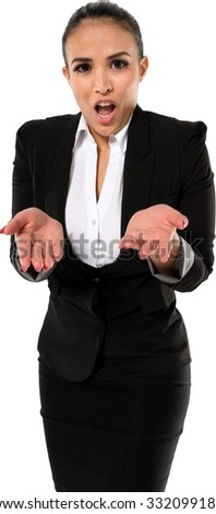 Shocked Hispanic young woman with medium dark brown hair in business formal outfit with hands open - Isolated