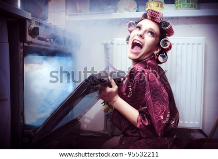 Shocked housewife in the kitchen baking something - stock photo