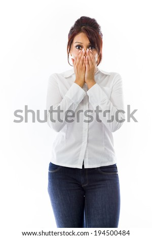 Shocked Indian young woman covering her face - stock photo