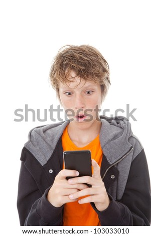 shocked kid reading message on mobile or cell phone - stock photo