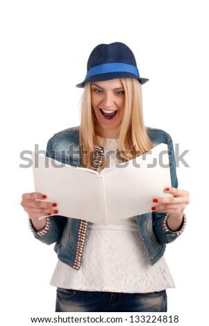 Shocked lady reading womens magazine - stock photo