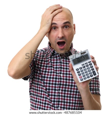Shocked man holding a calculator isolated on white background