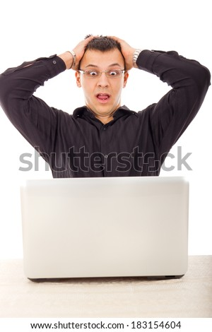shocked man in black shirt looking at laptop with wide eyes open - stock photo