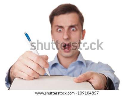 Shocked man isolated on white while signs an expensive bill or documents