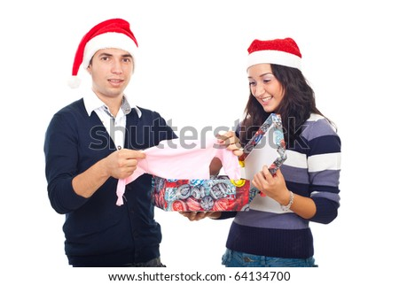 Shocked man just received the new he will be parent opening  his Christmas gift and discovering a baby cloth