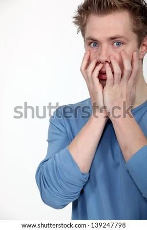 Shocked man on white background - stock photo
