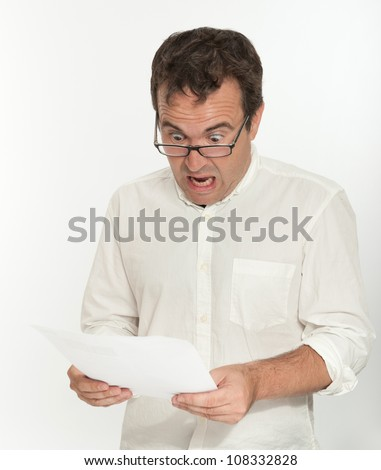 Shocked man reading a document