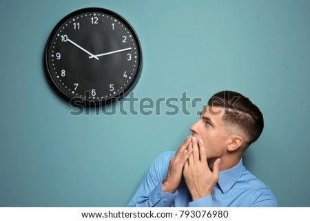 shocked manager looking clock hanging on stock photo royalty free