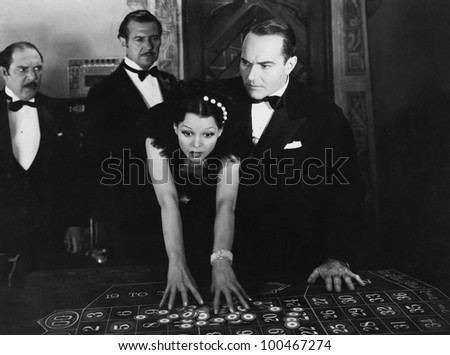 Shocked people at craps table - stock photo