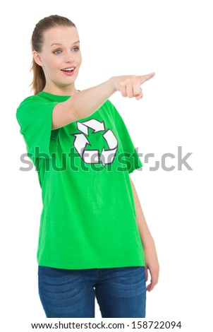 Shocked pretty environmental activist pointing something with her finger on white background - stock photo