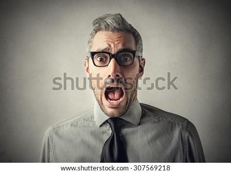 Shocked spellbound businessman - stock photo