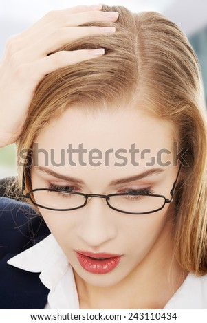 Shocked, surprised business woman sitting in front of laptop - stock photo