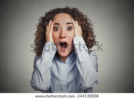 Shocked surprised stunned. Closeup portrait happy young woman looking excited in full disbelief hands on head it's me? isolated grey background. Positive human emotion facial expression reaction - stock photo