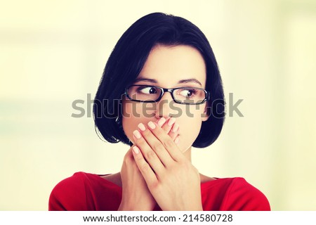 Shocked woman covering her mouth with hands, isolated on white - stock photo