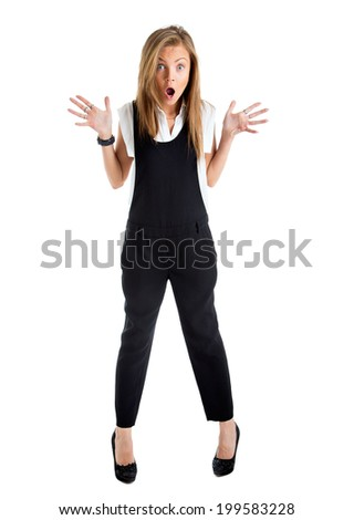 Shocked woman isolated. Businesswoman with funny surprised expression. Young business woman in full length looking at camera in high angle view.