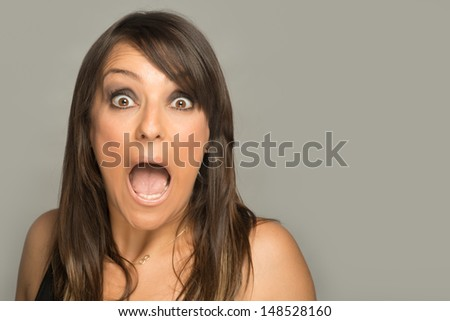 Shocked woman looking at camera