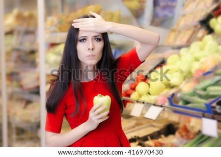 Shocked Woman with Green Pepper Shopping in a Supermarket - Portrait of a puzzled young girl looking for best vegetarian ingredients in a store  - stock photo