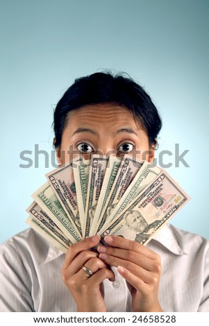 Shocked woman with money covering her face