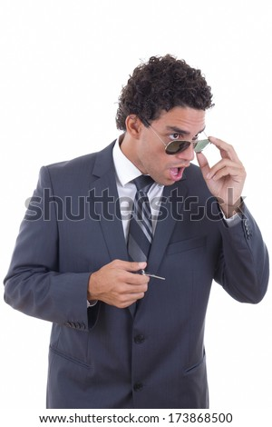 shocked young businessman with glasses holding keys - stock photo