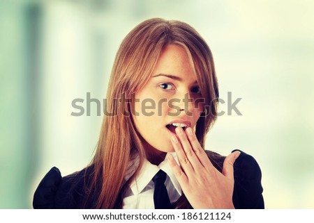Shocked young caucasian business woman in office - stock photo