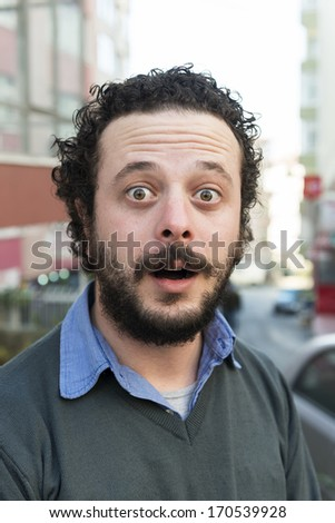 Shocked young isolated man - stock photo