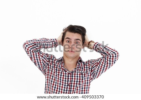 Shocked young natural student keeps the ears isolated on white background - stock photo