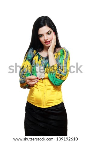 shocked young woman checking over the receipt and spending too much - stock photo