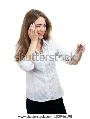 shocked young woman holding bill and spending too much - stock photo