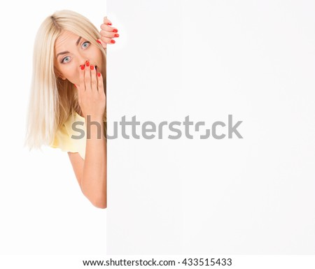 Shocked young woman holding blank board, isolated on white background