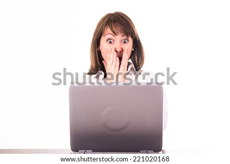 shocked young woman in front of the pc  - stock photo