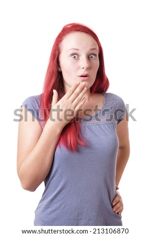 shocked young woman with eyes and mouth wide open - stock photo