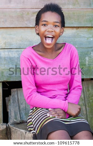 Shocking by what the photographer told her, followed by a big laugh. - stock photo
