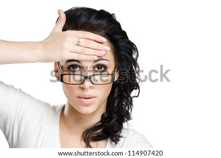 Shocking message, portrait of a beautiful young brunette woman with amazed facial expression. - stock photo