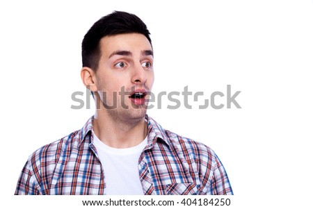 Shocking news. Portrait of surprised young man in casual shirt keeping mouth open while staring at camera while standing isolated on white - stock photo