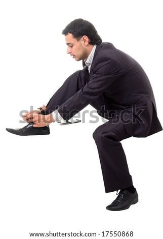 Shoe lacing. Serious businessman sitting against isolated white background
