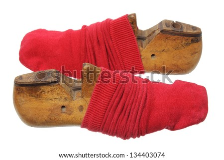Shoe Lasts and Red Socks on White Background - stock photo