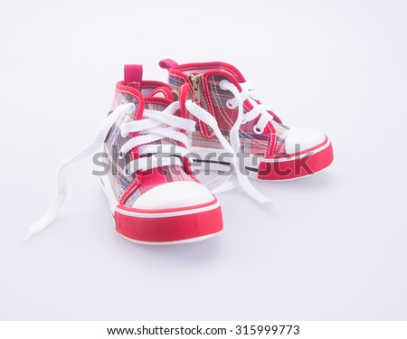 shoe or baby shoes on a background