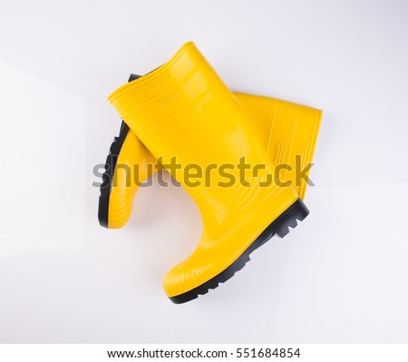shoe or yellow color rubber boots on a background