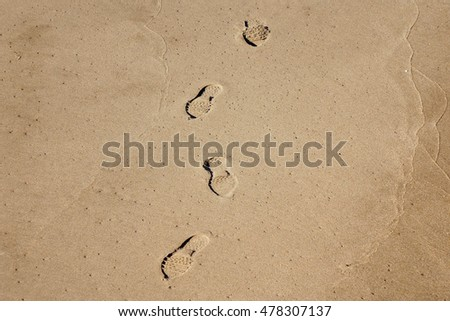 Shoe prints on the beach